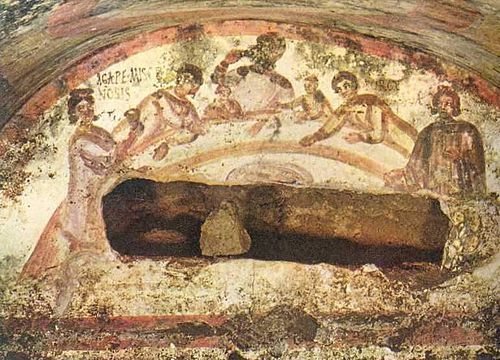 Fresco of a female figure holding a chalice at an early Christian Agape feast. Catacomb of Saints Marcellinus and Peter, Via Labicana, Rome